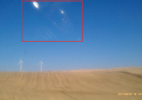 Photo Taken of White Orbs by Witness's Co-Worker (2 Hrs Later.)
