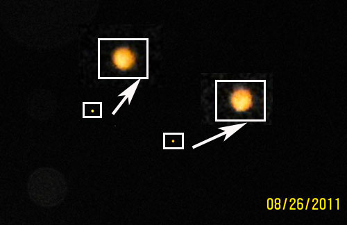 Photo & Enlargement of 2 Orange Orbs.