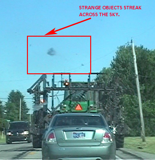 "Strange ""Streaking Objects"" Photographed by Witness."