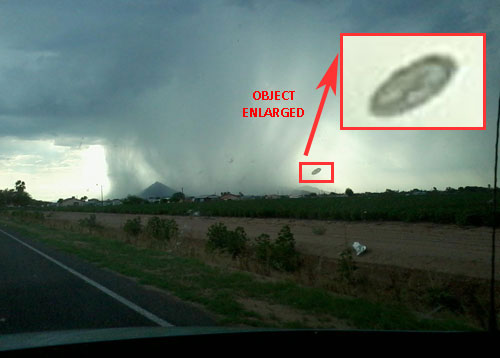 PHOTO & ENLARGEMENT OF STRANGE OBJECT NEAR THUNDERSTORM.