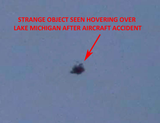ENLARGEMENT OF PHOTO OF STRANGE OBJECT HOVERING OVER LAKE MICHIGAN.