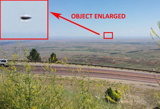 SCENIC PHOTO REVEALS DISK SHAPED OBJECT.