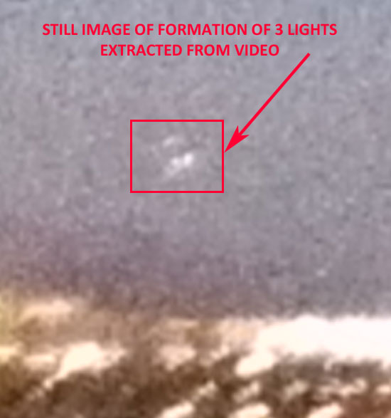 STILL IMAGE ENLARGED SHOWING LIGHTS IN TRIANGULAR CONFIGURATION.