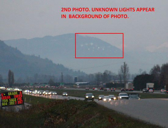 2ND PHOTO OF LIGHTS IN BACKGROUND OF PHOTO. LIGHTS APPEAR LOWER THAN 1ST PHOTO.