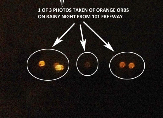 1ST OF 3 PHOTOS OF ORANGE ORBS TAKEN ON RAINY NIGHT.