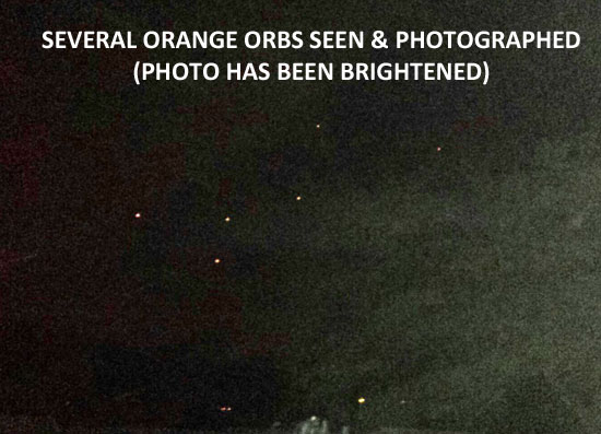 """BRIGHTENED"" PHOTO OF SEVERAL ORANGE ORBS."