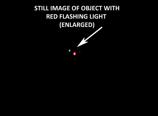 STILL IMAGE OF OBJECT WITH RED FLASHING LIGHT.