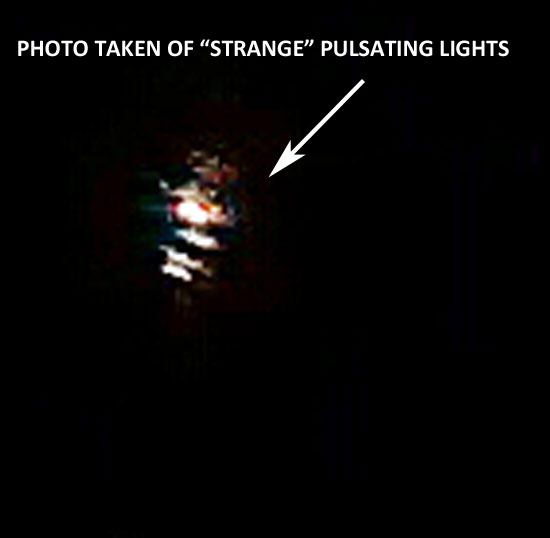 ENLAREMENT OF PHOTO OF PULSATING LIGHTS TAKEN BY WOMAN.