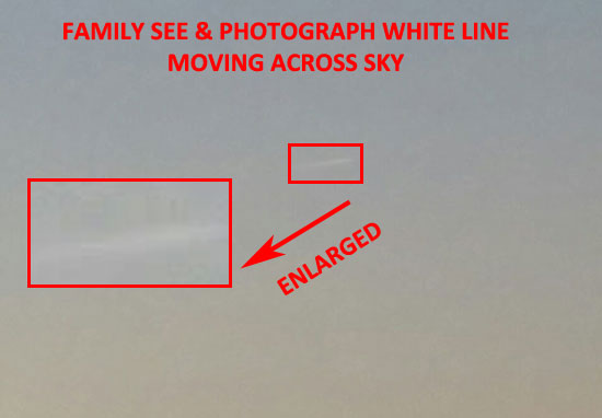 PHOTO OF WHITE LINE SEEN MOVING ACROSS SKY.