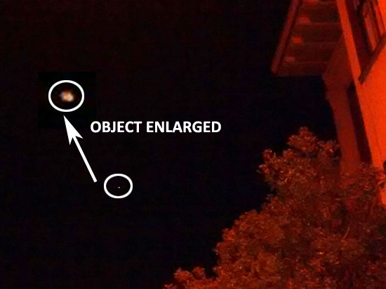 PHOTO & ENLARGEMENT OF ORANGE-YELLOW OBJECT.