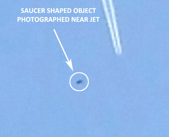 ENLARGEMENT OF PHOTO OF SAUCER NEAR JET.