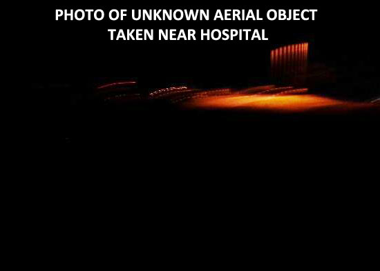 PHOTO OF UNKNOWN AERIAL LIGHTS.