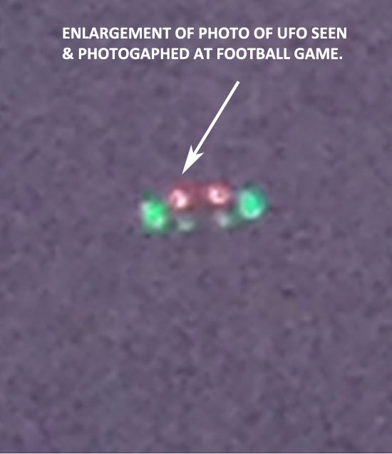 ZOOM OF UFO SEEN IN SKY AT HIGH SCHOOL FOOTBALL GAME.