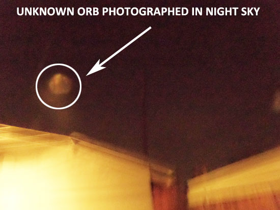 HOVERING ORB PHOTOGRAPHED IN NIGHT SKY.