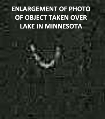 ENLARGEMENT OF PHOTO OF OBJECT TAKEN OVER LAKE.