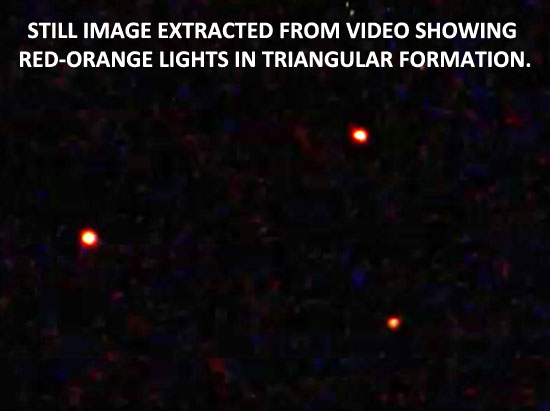 STILL IMAGE OF A TRIANGULAR FORMATION LIGHTS.