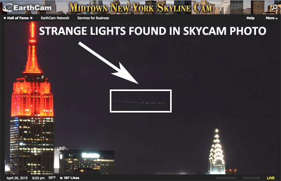 STRANGE FORMATION OF LIGHTS FOUND IN SKYCAM PHOTO.
