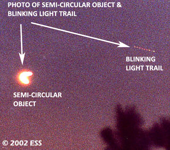 "PHOTO OF SEMI-CIRCULAR OBJECT & ""LIGHT TRAIL."""