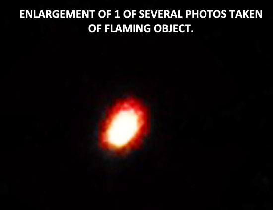 3X ENLARGEMENT OF 1 OF SEVERAL PHOTOS OF FLAMING OBJECT.