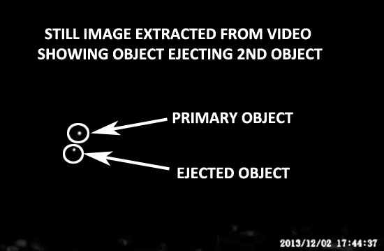 ENLARGED IMAGE OF UFO & EJECTED OBJECT EXTRACTED FROM VIDEO.
