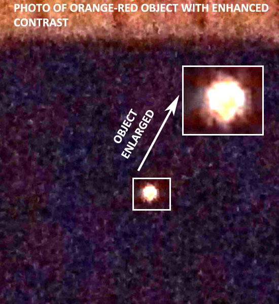 PHOTO & ENLARGEMENT OF ORANGE-RED OBJECT.