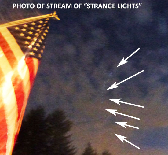 "ENHANCED PHOTO OF STREAM OF ""STRANGE"" LIGHTS."