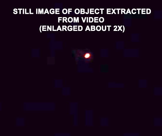 STILL IMAGE OF LARGE RED OBJECT EXTRACTED FROM VIDEO.