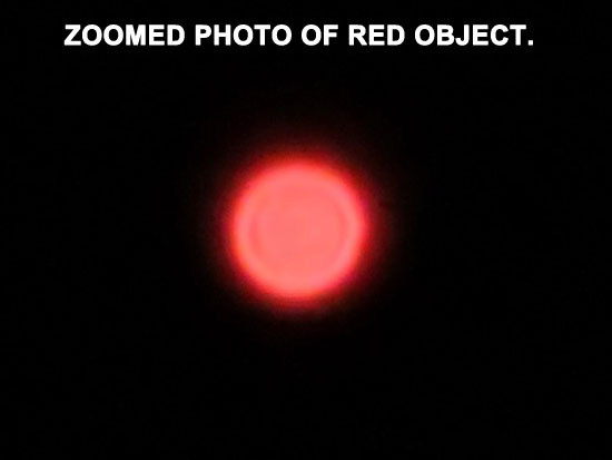 ZOOMED PHOTO OF BRIGHT RED OBJECT.