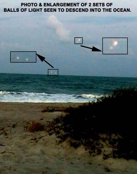 PHOTO OF 2 SETS OF LIGHTS SEEN OVER OCEAN.