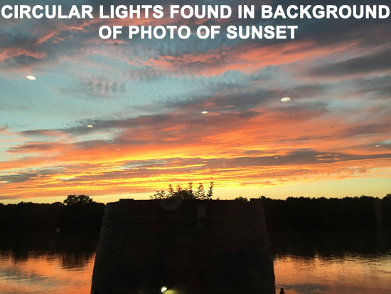 CIRCULAR LIGHTS FOUND IN BACKGROUND OF SUNSET PHOTO.