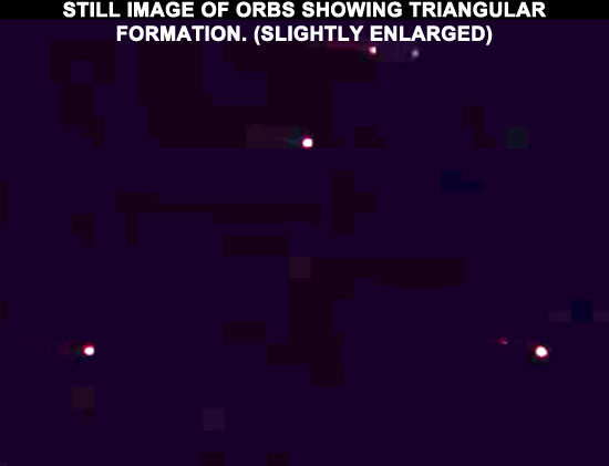 STILL IMAGE OF ORBS EXTRACTED FROM VIDEO. (SLIGHTLY ENLARGED.)