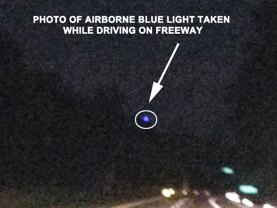 PHOTO OF AIRBORNE BLUE LIGHT TAKEN FROM FREEWAY.