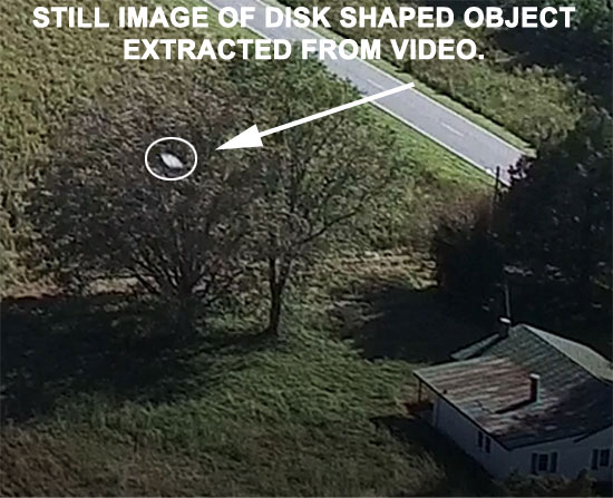 STILL IMAGE OF DISK SHAPED OBJECT EXTRACTED FROM VIDEO.
