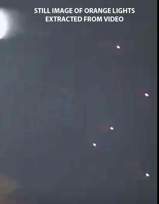STILL IMAGE OR ORANGE LIGHTS EXTRACTED FROM VIDEO (ENLARGED ABOUT 2X).
