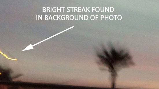 BRIGHT STREAK FOUND IN BACKGROUND OF PHOTO.