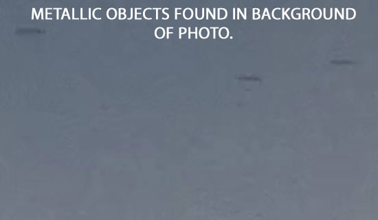 3 DISK SHAPED METALLIC OBJECTS FOUND IN BACKGROUND OF PHOTO.
