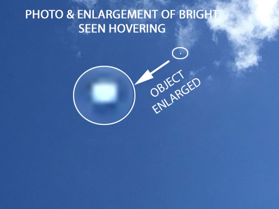 PHOTO & ENLARGEMENT OF HOVERING BALL SHAPED OBJECT.