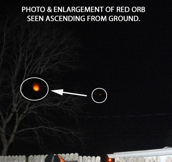 PHOTO & ENLARGEMENT OF RED ORB SEEN ASCENDING FROM GROUND.
