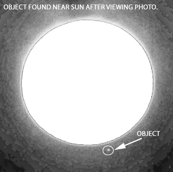BRIGHT OBJECT BY SUN FOUND IN PHOTO.