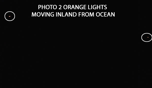PHOTO OF 2 OF ORANGE LIGHTS.