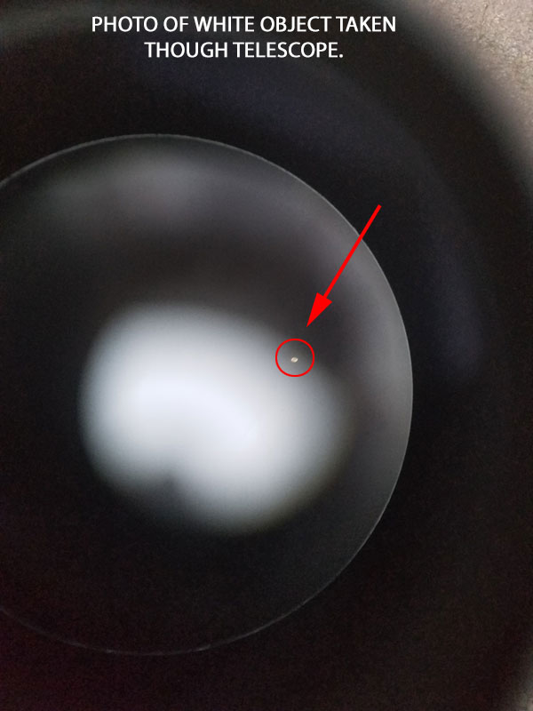 PHOTO OF WHITE OBJECT TAKEN THROUGH TELESCOPE.