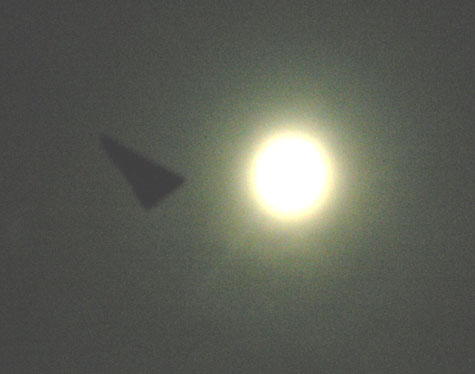 Brightened Photo of Dark Triangular Object Taken at Night.