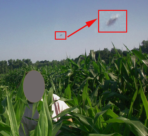 Photo and Enlargement of Flying Saucer. Face of Person Has Been Covered to Preserve Confidentiality.