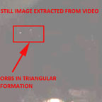Still Image Showing Orbs in Triangular Formation.