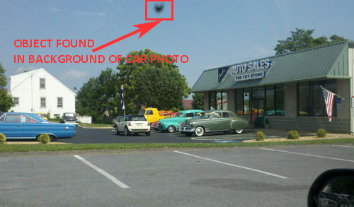 Object Discovered in Background of Car Photo.