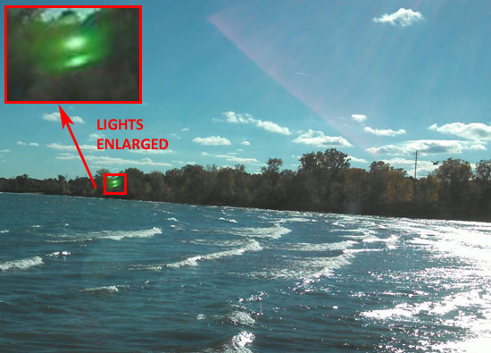 PHOTO OF LIGHTS & ENLARGEMENT. LIGHTS ARE LIKELY LENS FLARE.