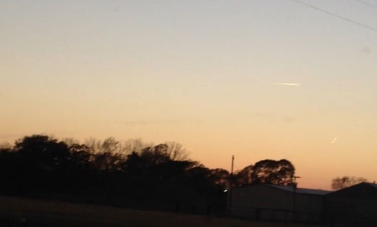 1ST OF 2 PHOTOS SENT BY WITNESS. WHITE STREAKS ARE LIKELY CONTRAILS.