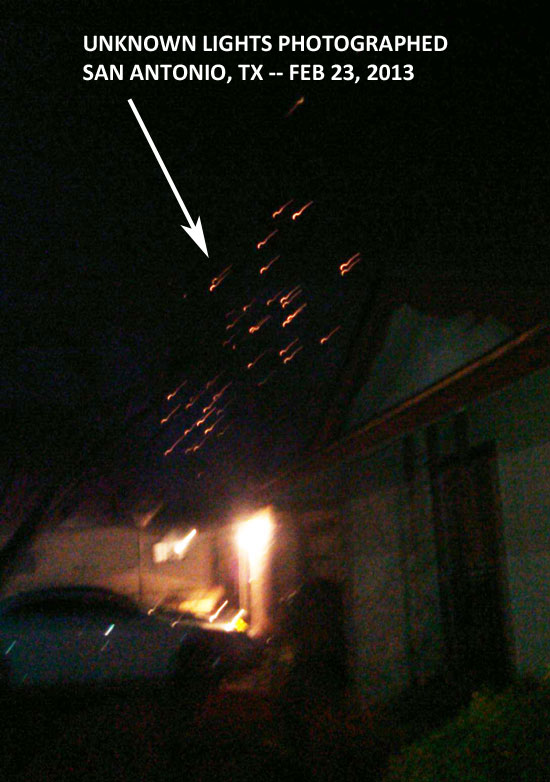 PHOTO OF NUMEROUS RED LIGHTS IN NIGHT SKY.
