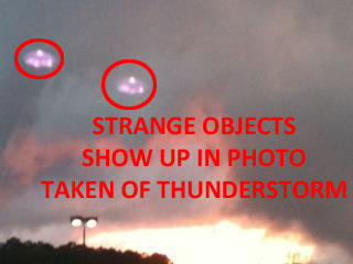 PHOTO (2ND OF 3 PHOTOS) OF STRANGE OBJECTS TAKEN FROM WALMART PARKING LOT.