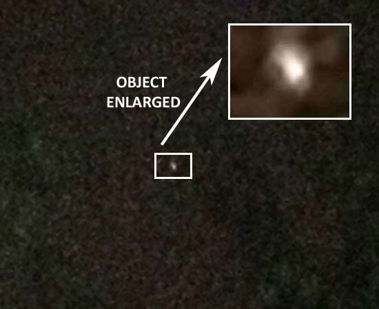 PHOTO & ENLARGEMENT OF FAST MOVING BRIGHT LIGHT.